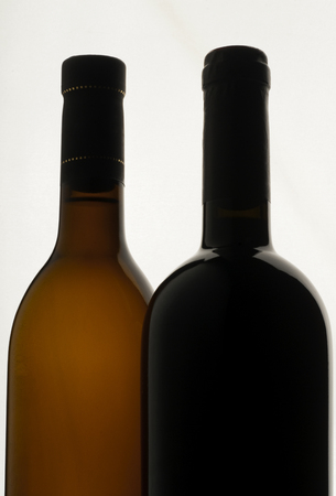 Two bottles of wine, white background, red wine and white wine Archivio Fotografico