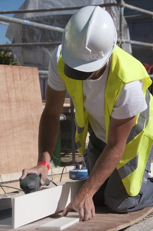 Worker sanding wood