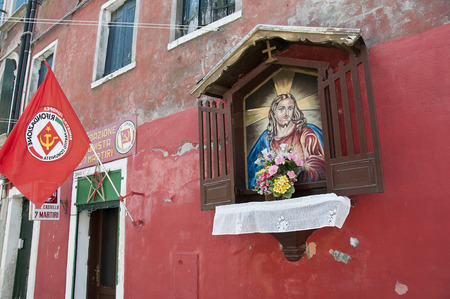Headquarters of communist party and image of Jesus Christ, Venice, Italy