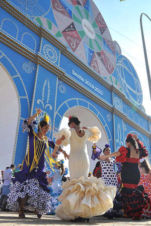 seville: SEVILLE, SPAIN, APRIL FAIR Dancing on the cover of the Seville Fair Editorial