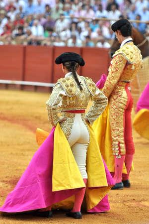 woman and men bullfighter