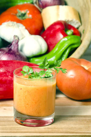 Soup of vegetables in glass with the ingredients of background photo