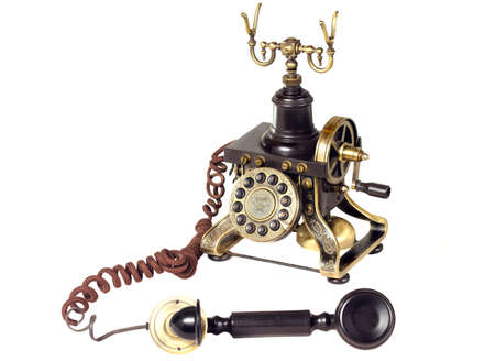 outbound: Antique telephone hook black and gold on white background Stock Photo