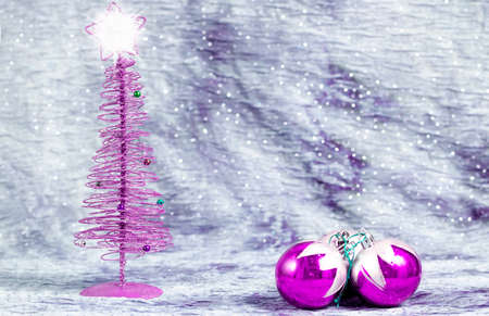 Christmas tree with bright star with balls on silver background, with space to write text photo