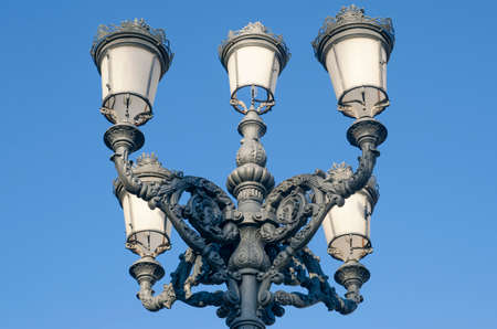 Classical lamp post made ​​of metal with sky blue trim easy Stock Photo