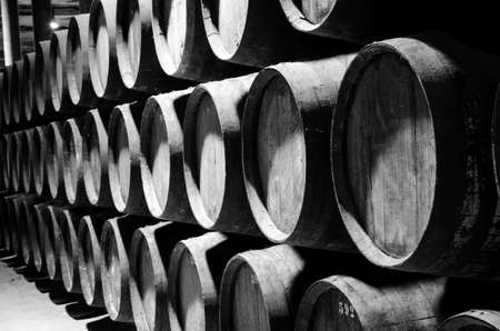 sherry: Wine barrels in the cellar in white and black