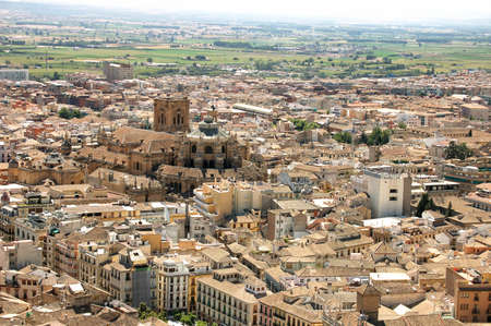 urbanistic: Aerial view of the city of Granada, with the cathedral in the background, Spain.