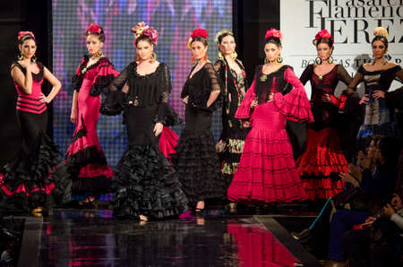 JEREZ DE LA FRONTERA, SPAIN - FEBRUARY 9  Models walk on the Carmen Vega catwalk during the Pasarela Flamenca Jerez 2014 Mercedes-Benz, In February 9, 2014 in Jerez de la Frontera, Spain