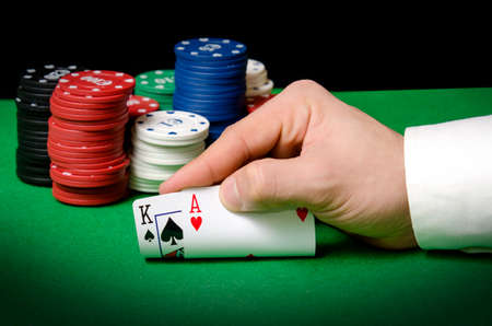 hold em: Hands in the foreground with ace and king