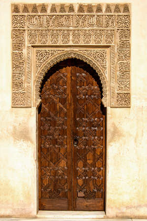 Arabian door style with beautiful mosaics in the Alhambra in Granada photo