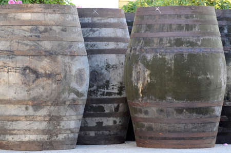 Wooden wine barrels stacked in foreign photo
