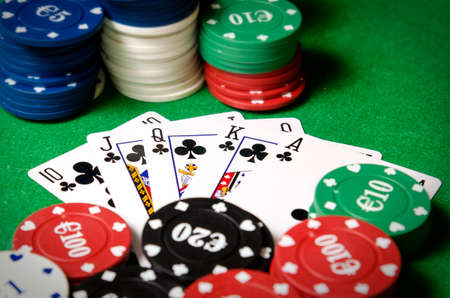 royal flush of shamrocks between betting chips Stock Photo