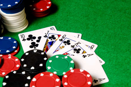 royal flush of shamrocks between betting chips