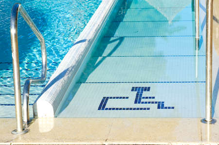 wheelchair access: Access to swimming pool for with handicapped symbol Stock Photo