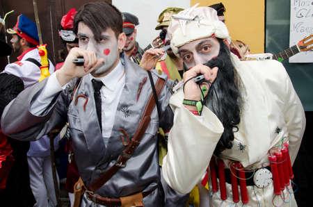 laden: CADIZ, SPAIN-MARCH 02: men dressed Hitler and Bin Laden in carnival parade Cádiz on march 02, 2014 in Cádiz