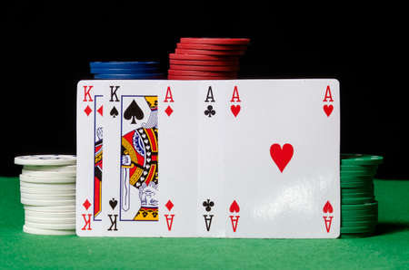 Hand of poker, full of aces and king with gambling chip  photo