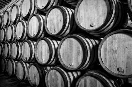 Old barrels for Whisky or wine in white and black photo
