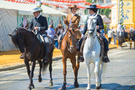 sherry: Seville, Spain, 8 may, 2014: People mounted on horse on fair of Seville. Editorial