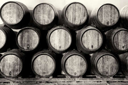 Old barrels for Whisky or wine on white and black photo