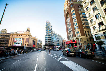 capitolio: MADRID, SPAIN - OCTOBER 18: View Gran Via with the Capitol Building, one of the main streets and most famous landmarks of the city, on october 18, 2014 in Madrid, Spain