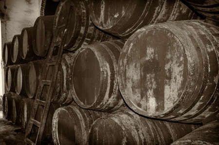 Old barrels for wine or whiskey in blanck and white Stock Photo