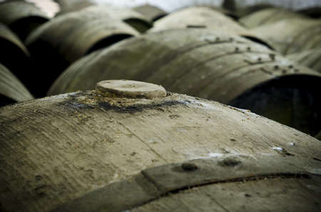 Detail of wine barrel, cap in the foreground photo