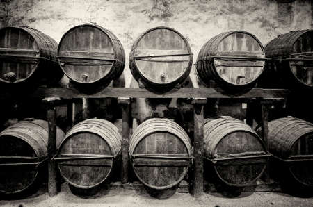 Barrels stacked in the winery in black and white photo
