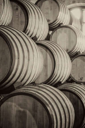 Old whiskey or wine barrels in black and white photo