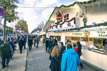 elysees: Paris, France - 15 November, 2014: Tourists visiting the traditional Christmas markets of the Champs Elysees Marche de noel des champs elysees in Paris, sunday, 15 november in Paris. Editorial