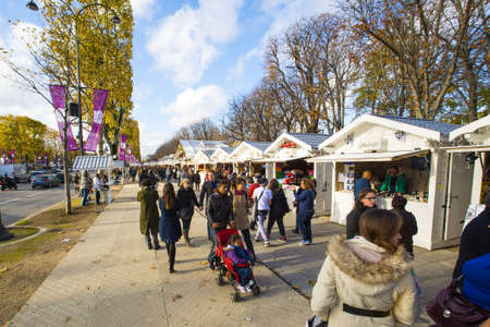 champs elysees: Paris, France - 15 November, 2014: Tourists visiting the traditional Christmas markets of the Champs Elysees Marche de noel des champs elysees in Paris, sunday, 15 november in Paris. Editorial