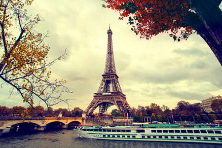 river boat: The eiffel tower in paris, while a boat cruise along the Seine