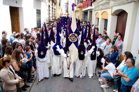 holy week in seville: SEVILLE. SPAIN - APRIL 14: Penitents of the brotherhood of El Beso de Judas  In their procession by Seville, In Holy week on april 14, 2014 in seville