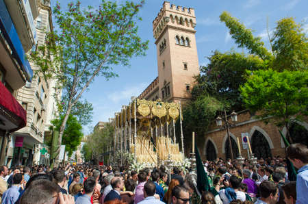 holy week in seville: SEVILLE. SPAIN - APRIL 14: The Virgin Virgen del Rocio of the brotherhood of El Beso de Judas  In their procession by Seville, In Holy week on april 14, 2014 in seville.