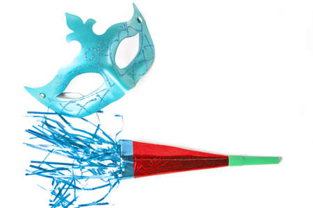 noisemaker: Carnival mask and blower in white background