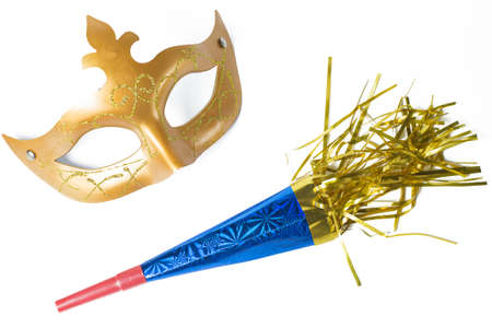 Carnival mask and blower in white background