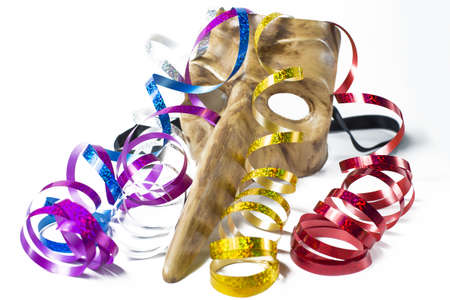 blowers: Carnival mask with colorful streamers on white background