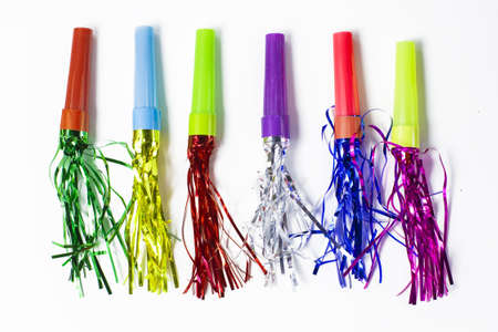 blowers: Party Horn Blower with colored streamers on white background Stock Photo