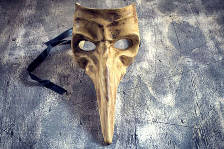 Classical venetian carnival mask on wood