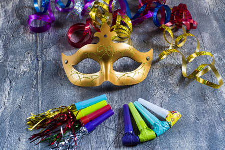 blowers: Carnival mask with colorful streamers and party blowers