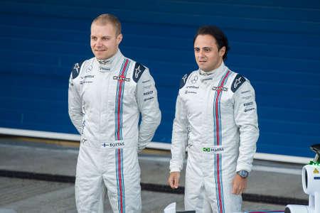massa: JEREZ DE LA FRONTERA, SPAIN - FEBRUARY 01:  Felipe Massa and Valtteri Bottas, pilot of the team Williams in test Formula 1 in Circuito de Jerez on feb 01, 2015 in Jerez de la frontera Editorial