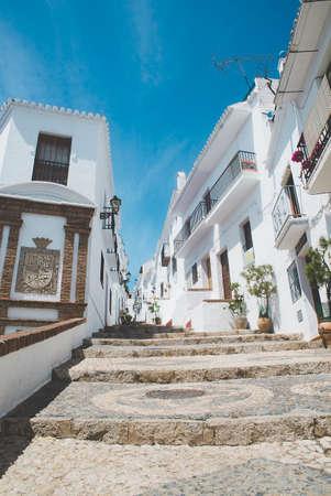 frigiliana: Typical street in Frigiliana, Andalusia, Spain. Stock Photo