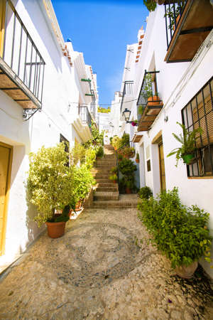 Typical street in Frigiliana, Andalusia, Spain. Stock Photo