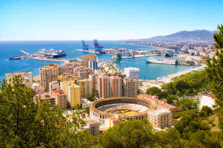 culture: View of Malaga with bullring and harbor. Spain Stock Photo