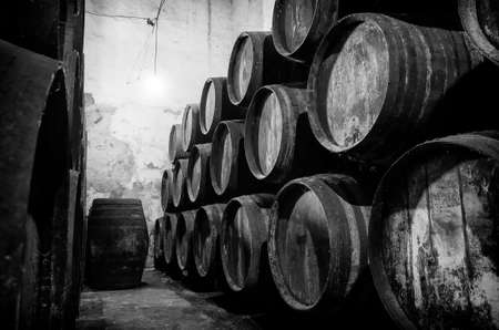 Old barrels for Whisky or wine in winere in black and white