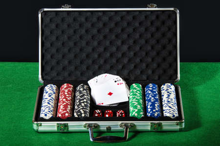betting: Briefcase poker with cards and dice betting Stock Photo