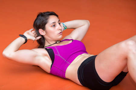 Young woman doing abdominal photo