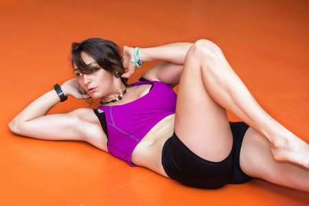 situps: Young woman doing abdominal