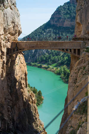 safer: ARDALES (MALAGA), SPAIN - APRIL 17: Tourists walk along the El Caminito del Rey (Kings Little Path), Worlds Most Dangerous Footpath reopened in May 2015 a safer footpath was installed above the original. On apr 17, 2015 in Ardales (Malaga, Spain). Editorial