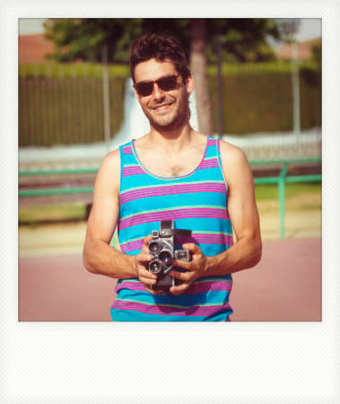 cinematographer: Instant photo of young man with old film camera