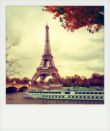 eiffel: Instant photo of  The eiffel tower in paris, while a boat cruise along the Seine